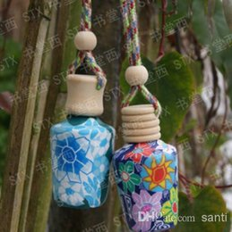 Wholesale Fashion Hot ml Car hang decoration Ceramic essence oil Perfume bottle Hang rope empty bottle
