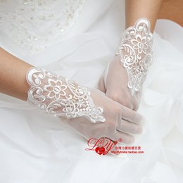 Wholesale 2015 new arrival beautiful and cheap bridal gloves wrist length beige bridal gloves in stock and can shipping now