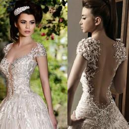Wholesale Rami Salamoun Glamorous RhinestoneS Lace Applique Beads Cristaux Fleurs Robes de mariée Cap Sleeves Longueur du plancher Robe de mariée de luxe