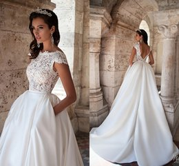 Wholesale Modest Wedding Dresses Lace Top Cap Sleeve Backless with Pockets Bateau Neck Ruffles Satin Spring Garden Plus Size Bridal Wedding Gowns
