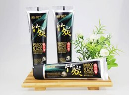 Wholesale g bamboo charcoal Black toothpaste teeth whitening freshen breath suppress gums bleeding removing teeth stains dental cream