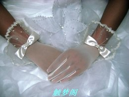 Wholesale Bride elastic mesh bowknot pearl gloves Beige brief paragraph yarn gloves Suitable for any shape of the hand