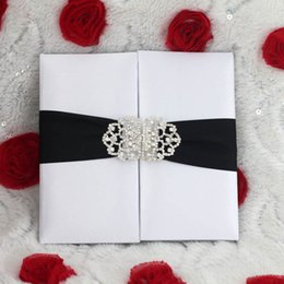 Wholesale White Silk Folder Wedding Invitation Card With Silver Ribbon And Silver Embellishment And Paper Box For Mailing