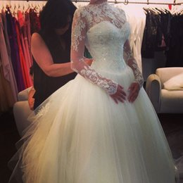Wholesale Stunning iovry tulles Ball Gown Sheer Wedding Dresses with long sleeves bateau backless lace appliques sequins formal bridal gowns