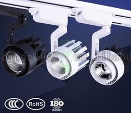 Luces de la pista de la COB LED 15W 20W 30W Para la tienda de ropa que fija la exhibición de la pared COB luz de la pista 85v-265v 3 colores Shell LLWA042