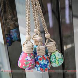 Wholesale 15 ml Car hang decoration Ceramic essence oil Perfume bottle Hang rope empty bottle random colors styles