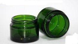 Wholesale g Green glass cosmetic Cosmetic Jar glass cream jar amber glass bottle cap black white gold cap