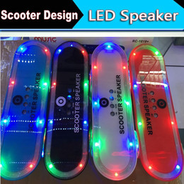 online shopping Newest Christmas gift Skateboard Bluetooth Wireless scooter Speaker Mobile Audio Mini Portable Speakers with Led Light OM XL2