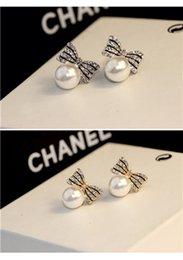 Wholesale Womens Earrings Womens Fashion High grade Diamond Ornament and Bowknot Earrings Hot Lady Hypoallergenic Earrings