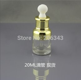 Wholesale NEW ARRIVAL ml transparent glass dropper bottle with gold shoulder and gold collar white bulb glass bottle