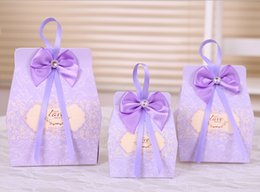 Wholesale In stock pink lavender bow paper wedding favors hot sale vintage candy box party favors with bowknot ribbon candy bags