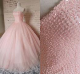 Wholesale Vestidos de anos Vestidos de Quinceañera de color rosa diseñados con rebordear el vestido de bola de Tulle sin mangas Vestidos de debutante Masques Prom Dresses