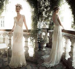 Wholesale Vintage A Line Wedding Dresses Lihi hod Lace Bohemian Deep V neck Backless Boho Bridal Gowns Sweep Train Applique Cap Sleeves Custom