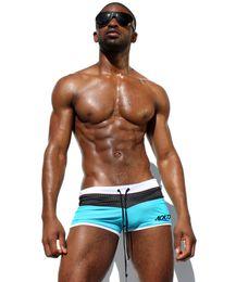 Wholesale Original Aqux Men Swimwear Swimming Boxer Shorts Beach Surf Board Short Trunks Men s Swimsuit Brand Mens Swim Suits Gay Penis Pouch WJ
