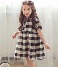 Wholesale Summer children plaid dress korean style Girls buckle short sleeve dress kids princess dress children cotton clothing red black A9068