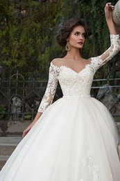 Wedding dress with red ribbon
