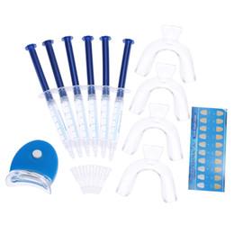 Dientes blanqueadores dentales del blanqueador del diente 12pcs que blanquean el cuidado de las bandejas que blanquean el kit casero del equipo del peróxido del 44% del peróxido W2752