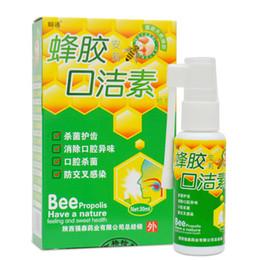 Al por mayor-30 ml de abeja propóleo boca limpia spray oral, el tratamiento del mal aliento tratamiento de la halitosis úlcera faringitis oral, refrescante del aliento