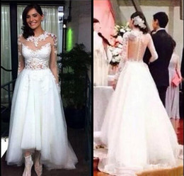 High Low Tulle Wedding Dresses Jewel Neck Applique Lace Long Sleeves Bridal  Gowns Buttons See Through Back Sexy Vestidos De Novia df5390ea1bb7