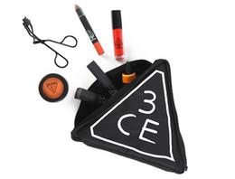 Wholesale Hot sales fashion cosmetic bags makeup bag Letter Bags Korea stylenanda CE zipper Triangle trend Portable black PU BAG