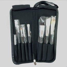 Wholesale El precio bajo fijó los cepillos profesionales calientes del cepillo del maquillaje de la marca M con la bolsa de cuero de la cremallera