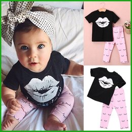 Wholesale baby girls short t shirts black white lip tops children eyes grometric long pants clothing suits lovely pink style hot selling real factory