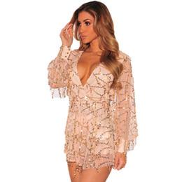 Wholesale 2016 Sexy Club de fiesta Deep V cuello Champagne Sequined Bodysuit manga larga del mameluco atractivo ahueca hacia fuera la borla del cequi pone en cortocircuito el vestido de noche del mono