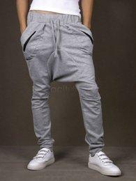 Wholesale Pantalones elásticos del deporte del bolsillo de la cintura de los pantalones elásticos flojos del Harem del cordón de los hombres flojos del cordón para los hombres M XXL del color de los hombres más tamaño