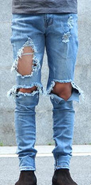 Wholesale kpop skinny ripped korean hip hop fashion pants cool mens urban clothing jumpsuit men s jeans kanye west slp fear of god