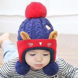 Wholesale HQ invierno nuevos niños lindo ojo de gatito más terciopelo caliente sombrero Moda de punto ganchillo casquillo con muñeca de oído muchachos chicos Beanie FHJ910