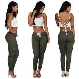 Wholesale Recomiende colores popular estilo americano mujeres sexy pantalones vaqueros apretados pierna lateral bolsillo niñas Capris Fitness más tamaño