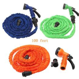 Stocks américains! Multi-color 100FT Flexible flexible d'eau de jardin extensible avec tête de buse de pulvérisation 3 couleurs Livraison gratuite