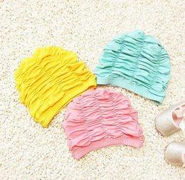 Wholesale Grossiste enfants en couleur solide bébé tuba cheveux oreille rose chapeau en tissu confortable pli personnalité filles natation cap