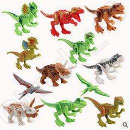 La nueva serie jurásica del dinosaurio del mundo 12pcs / set cifra los bloques huecos que los sistemas juega los ladrillos CCA5425 de los juguetes de Minifigure 30set