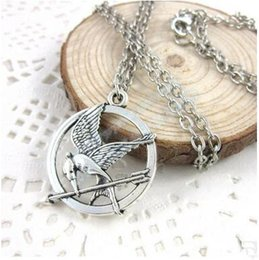Hunger games mockingjay necklace nz buy new hunger games the hunger games necklaces inspired mockingjay and arrow pendant necklace authentic prop imitation jewelry katniss movie the hunger games aloadofball Images