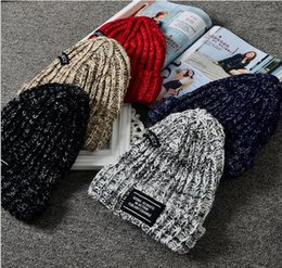 Discount wholesale knitted cashmere hat Mixed color wool hat Korea autumn and winter thickening plus cashmere warm hat men and women knitted hat tide