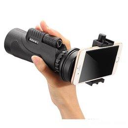 Alta calidad Amplíe el telescopio universal de la lente de cámara del concierto que camina 12x50 monocular con el sostenedor para el androide IOS Smartphone que envía libremente