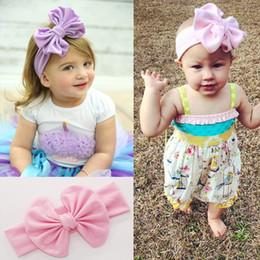 Аксессуары для волос Baby Girl Эластичная ткань Лук Дети Headdress для фестиваля или партия Маленькие дети Группа волос Одежда Бесплатная Доставка