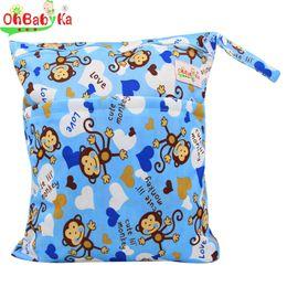 Wholesale Vente en gros OhBabyKa Baby Diaper Sacs Impression De Caractère Changement De Sacs Mouillés Baby Tissu Couches Sacs x40cm Marque Bébé Nager Sac à couches Nappy