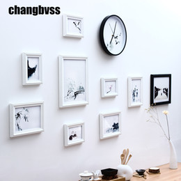 Wall Hanging Photo Frames Designs 12 opening plastic wall hanging photo collage picture frame New Modern Style Wooden Wall Hanging Photo Frames Simple 9 Pcs Set Wall Picture Frames Chinese Ink Painting Wall Picture Frames With Clock