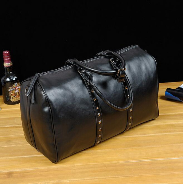 Factory direct brand bag rivets bag leisure mens personality trend of large capacity Leather Men's hand luggage