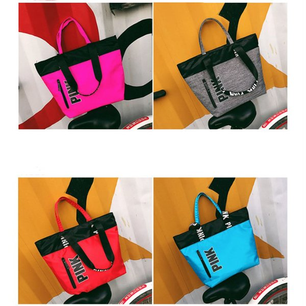 Whole ale 4 color pink handbag houlder bag higt quality women de igner bag large capacity travel triped waterproof beach fa hion bag