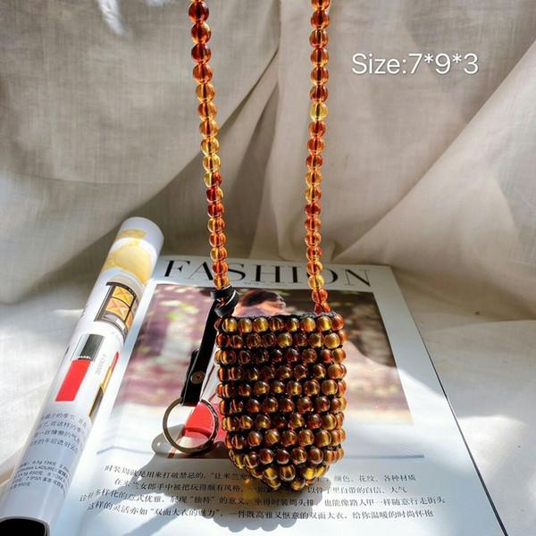 2020 spring and summer new style handmade pearl woven bag mini bucket bag fashion womens handbags and purses (527496565) photo