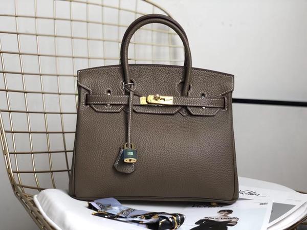 Бесплатная доставка модельер женская сумка сумка коричнево-серый кожа телячья кожа сумка сумки золото Оборудование 35 см новый