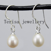 Wholesale woman s earring New white color real pearls in over shape with siliver hooks