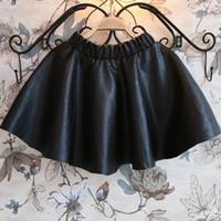 al por mayor falda plisada bebé-Venta al por mayor a 2015 meninas Saia invierno \ otoño pequeñas faldas para el bebé \ \ niños niños, las niñas de imitación de cuero negro faldas plisadas