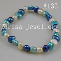 Wholesale New Style A132 AA Pearls Size mm length inch Mix Color Fresh Water Pearls Elastic Bracelet