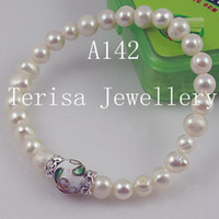 Wholesale New Style A142 AA Pearls Size mm length inch Mix Color Fresh Water Pearls Elastic Bracelet