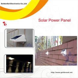 Оптовая Открытый Lampara солнечной энергии 4LED освещение Тропинка Up-Лестничный Wall Garden Двор Солнечная лампа солнечная панель zonnepaneel Pannello Solare от Производители lampara панель