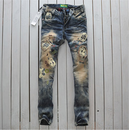 Wholesale male fashion nostalgia slim jeans vintage playing cards straight denim trousers